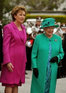 The Queen arrives in Ireland, greeted by President Mary McAleese)
