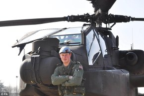 Prince Harry in front of his Apache while on training in the States