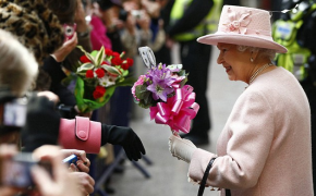 "The Queen accepts a bouquet of flowers with a special ""60"" ornament celebrating her sixty years on the throne during her Diamond Jubilee summer."