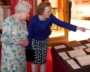 H. M. The Queen is shown the private diaries of Queen Victoria by the curator of the Royal Collection, Lady Jane Roberts.