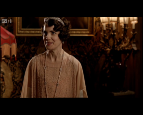 The Countess of Grantham wearing a lovely peach ensemble