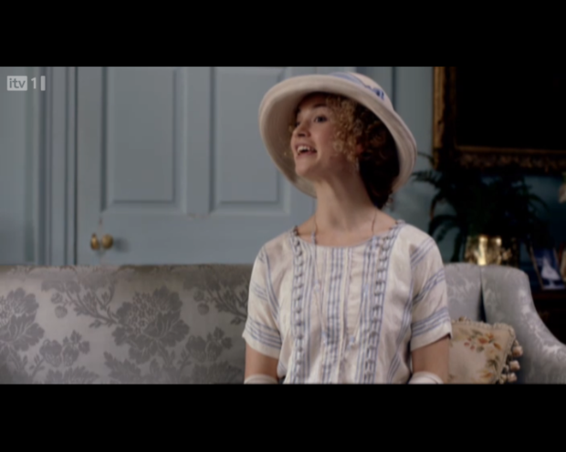 A fresh face at Downton Abbey - cream ad pastel blue day dresses are the hot trend for twenties teens.
