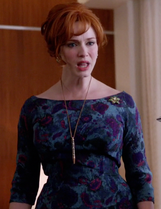 Christina Hendricks stars as Joan Holloway in Mad Men, wearing a gorgeous blue foral dress with a bateau neckline.