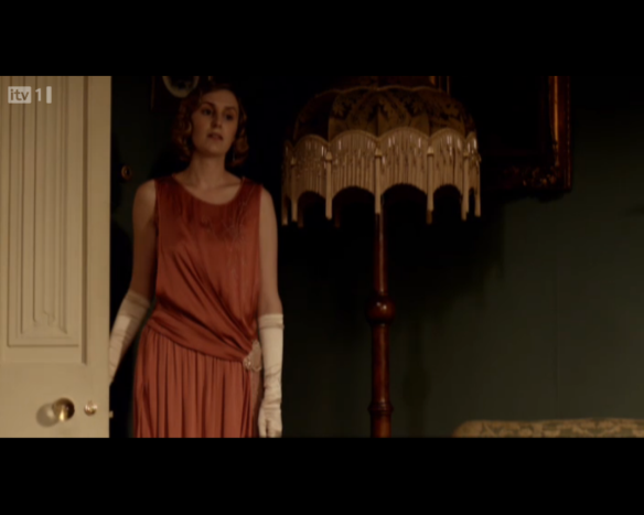 lady edith in a burnt orange twenties evening dress