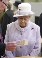 Did the Queen dress to match the purple of our bank notes?
