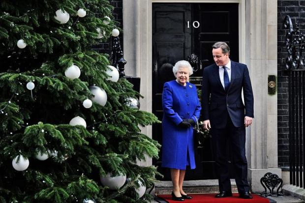 The Queen at 10 Downing Street, wearing a stylish royal blue coat with a round neckline.