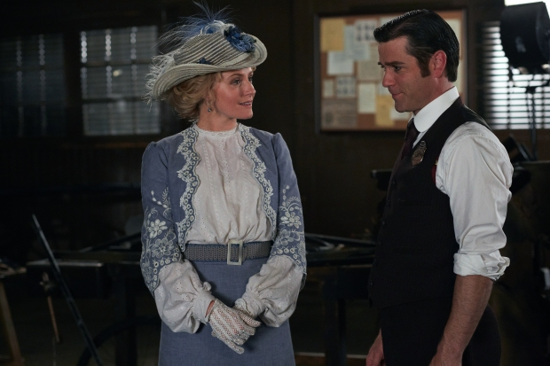 Dr. Ogden (Hélène Joy) and Detective Murdoch (Yannick Bisson) discuss their relationship, as well as her wonderful new dress and hat.
