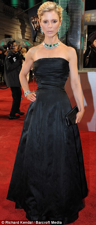 Emilia Fox chanels classic chic in this 1950s style evening gown, set off by emeralds.