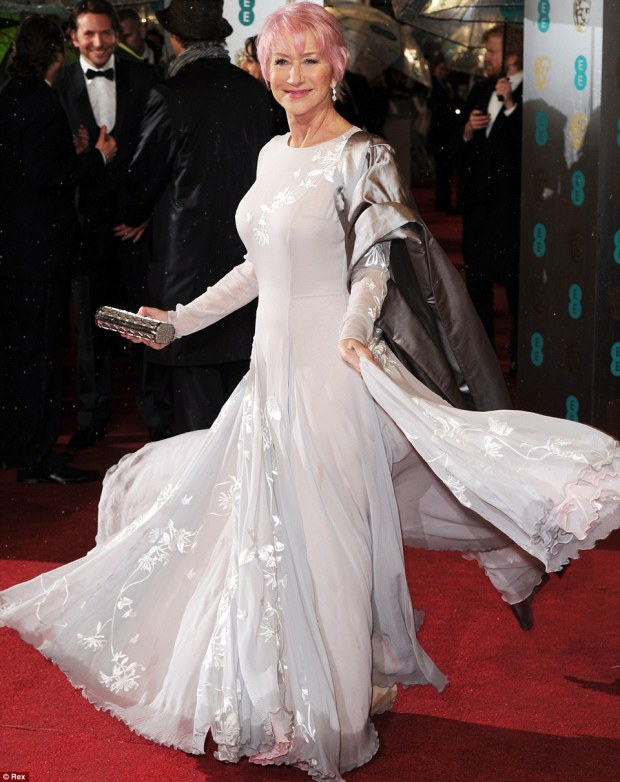 Dame Helen Mirren wins the award for the best dressed at the BAFTAs in 2013. Her stylishly understated sheer ivory gown is brought to life by the ornate floral embroidery. The ensemble is set off perfectly by Helen Mirren's pink lipstick, which matches her new candy pink hair. This wonderful ensemble showcases Helen Mirren's sense of style and it also refelcts her adventurous and fun personality. Simply stunning!