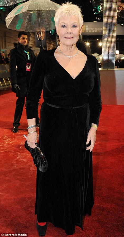 Dame Judi Dench proving that style gets better with age. A classic LBD with a stunningly flattering neckline, this gorgeous evening gown shows off Judi Dench for the chic and sophisticated lady she is.