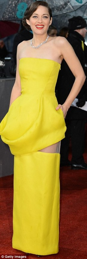 Marion Cotillard wore a bright daffodil-yellow Christian Dior gown, opting for an eye-catching clashing red liptstick to set the outfit off. A fashionable choice, pulled off with panache.
