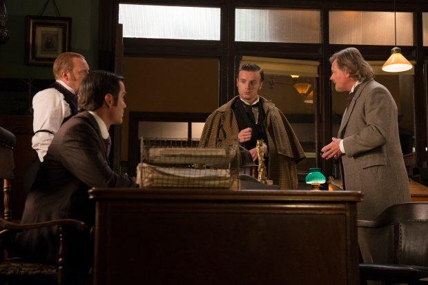 Brackenreid (Thomas Craig) and Det. Murdoch (Yannick Bisson) question Sherlock Holmes (guest star Andrew Gower).