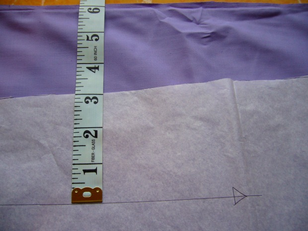 use a tape measure to make sure the grainline sits parallel to the salvage edge