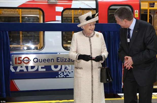 "H. M. unveils a new train, the ""Queen Elizabeth II""."