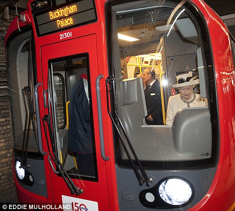 The queen has a go at driving a train on the underground – where is