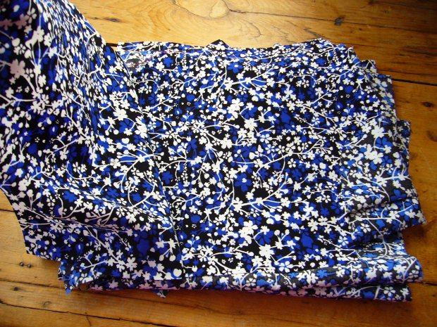 A lovely pattern, but a real challenge to push a pin through. I finally got all the pieces cut out, and felt exhausted. On the plus side, I'm pretty sure that this man-made fabric is indestructible and most likely fire proof too. But none of these qualities are conducive towards a novice dressmaker.