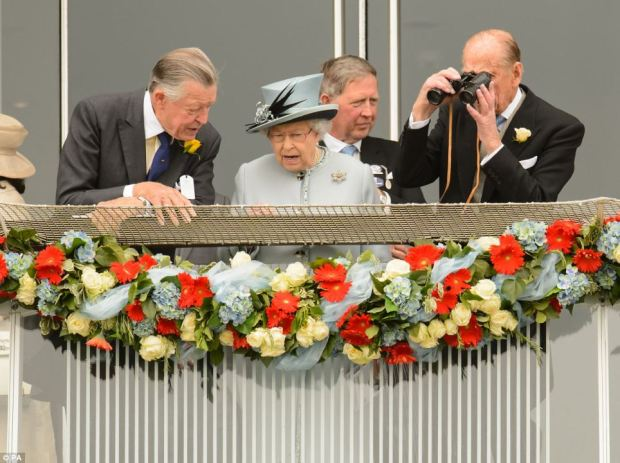 The Queen pays keen attention to horse racing from the royal box
